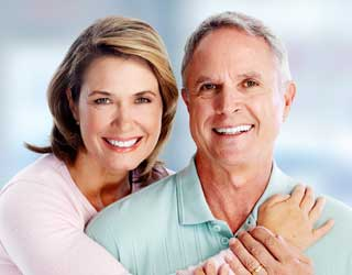 Smiling Elderly Couple Dental Implants